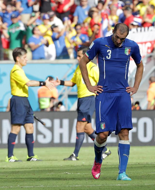 Italy's Giorgio Chiellini bows his head after the group D World Cup soccer match between Italy and Costa Rica at the Arena Pernambuco in Recife, Brazil, Friday, June 20, 2014. Costa Rica won the match 1-0. (AP Photo/Antonio Calanni)