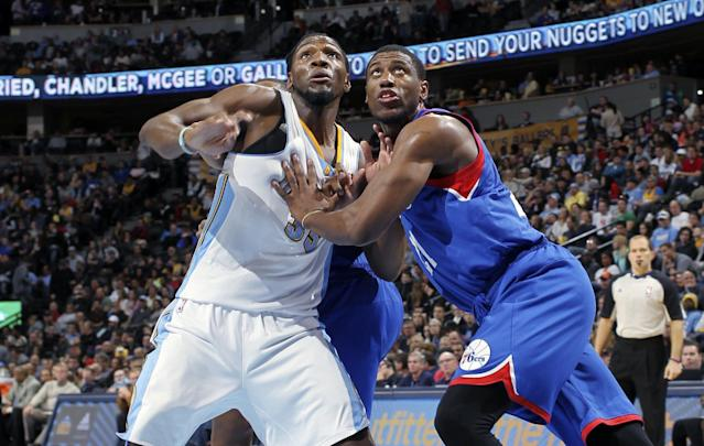Philadelphia 76ers forward Thaddeus Young, right, battles for position for a rebound with Denver Nuggets forward Kenneth Faried in the third quarter of the Sixers' 114-102 victory in an NBA basketball game in Denver on Wednesday, Jan. 1, 2014. (AP Photo/David Zalubowski)