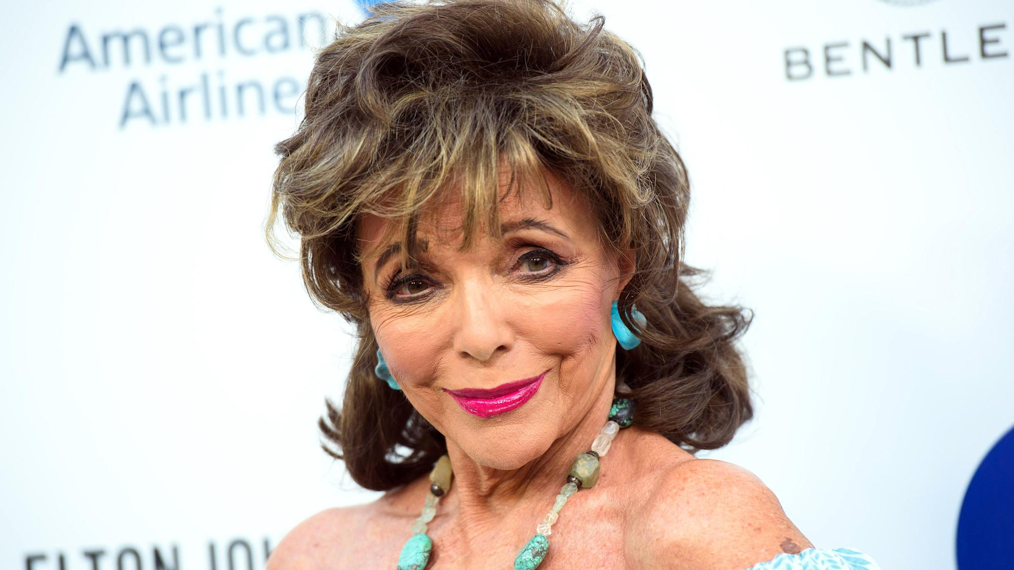 Dame Joan Collins latest famous face to get Covid-19 jab