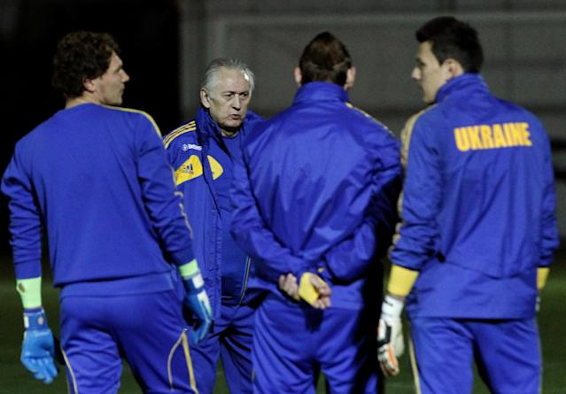 Ukraine soccer coach, Mykhailo Fomenko, facing, speaks to his players during a training session in the Ayia Napa resort on the southeast of the island of Cyprus, Tuesday March 4, 2014. The Ukrainians will play the United States in a friendly match on Wednesday in Cyprus, after the match was moved from Kharkiv in Ukraine to Larnaca in Cyprus for security reasons. (AP Photo/Petros Karadjias)