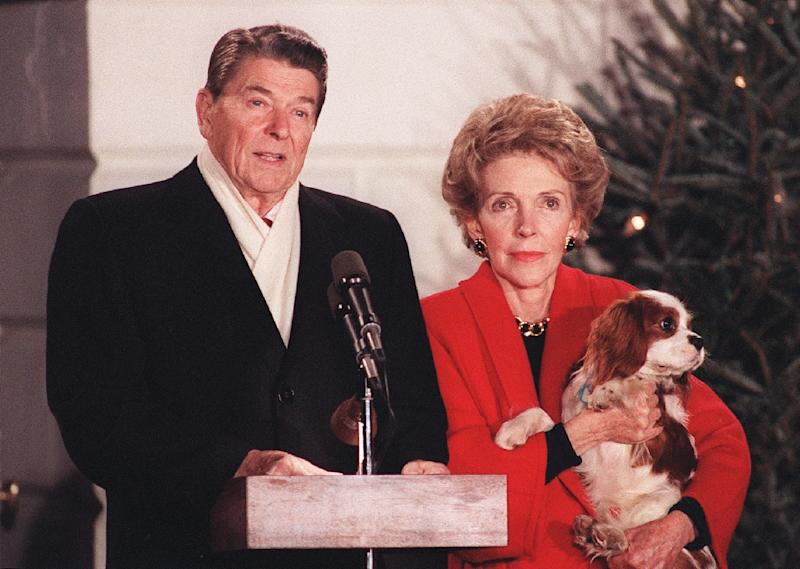 Former president Ronald Reagan, seen here with wife Nancy, rose from Hollywood to the White House (AFP Photo/MIKE SARGENT)