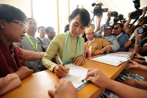 Myanmar opposition leader Aung San Suu Kyi signs the regristration list before attending the parliament session in Naypyidaw on July 9. Suu Kyi made her historic parliamentary debut Monday, marking a new phase in her near quarter century struggle to bring democracy to her army-dominated homeland