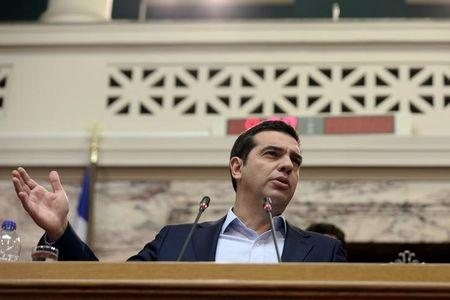 Greek PM Tsipras addresses his lawmakers during a ruling Syriza party parliamentary group session in Athens