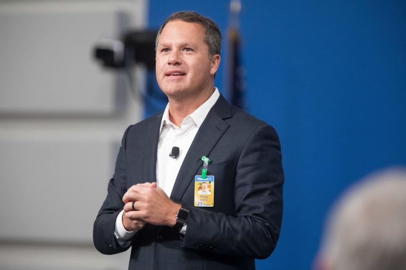 IMAGE DISTRIBUTED FOR WALMART - Walmart President and CEO, Doug McMillon, announced today that Walmart will give hiring preference to military spouses, becoming the largest U.S. company to make such a commitment. This announcement came during a Veterans Day ceremony on Monday, Nov. 12, 2018 in Bentonville, Ark. (Gareth Patterson/AP Images for Walmart)