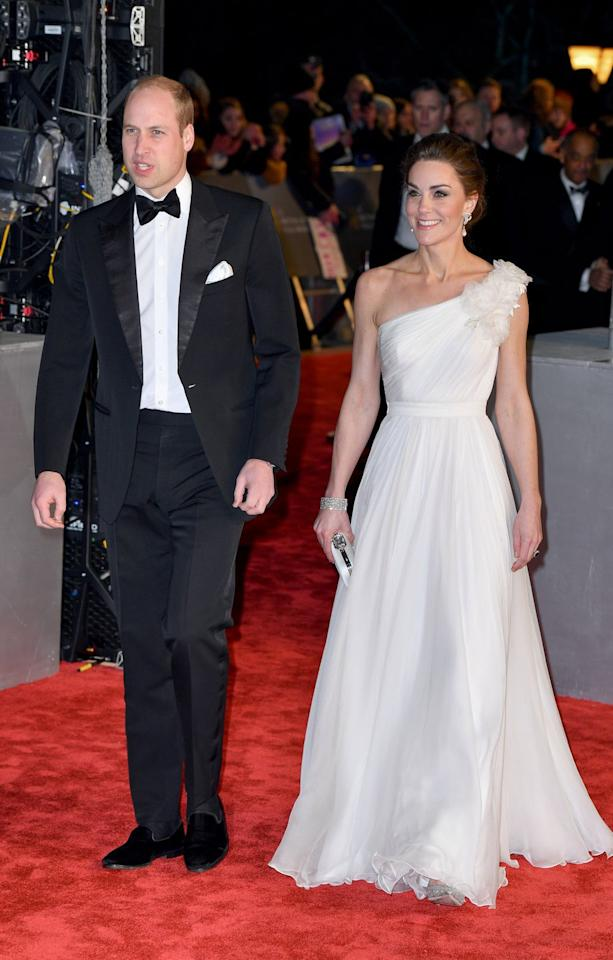 "<p>Kate wore a white Alexander McQueen gown to the 2019 BAFTAs, paired with <a rel=""nofollow"" href=""http://www.selfridges.com/GB/en/cat/jimmy-choo-romy-85-speckled-glitter-courts_834-10132-J000108848/"">glittering Jimmy Choo court shoes</a> and <a rel=""nofollow"" href=""https://www.harpersbazaar.com/uk/fashion/jewellery-watches/a26282545/kate-middleton-princess-diana-earrings-tribute-baftas-2019/"">earrings that once belonged to Princess Diana</a>. William was dapper in a black tux and bow-tie.</p>"