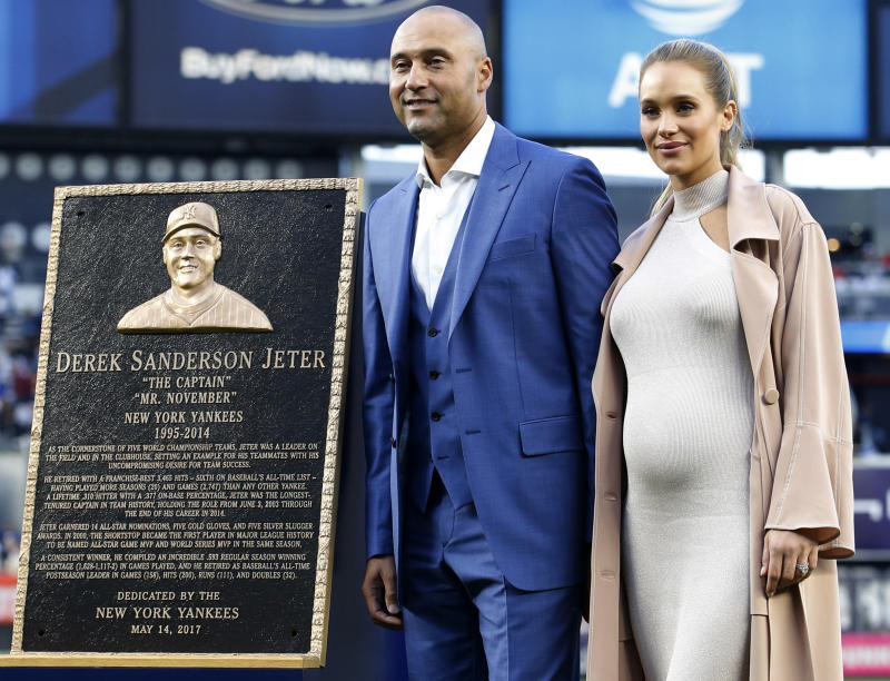 Derek Jeter and his wife Hannah at his number retirement ceremony in May. (AP)