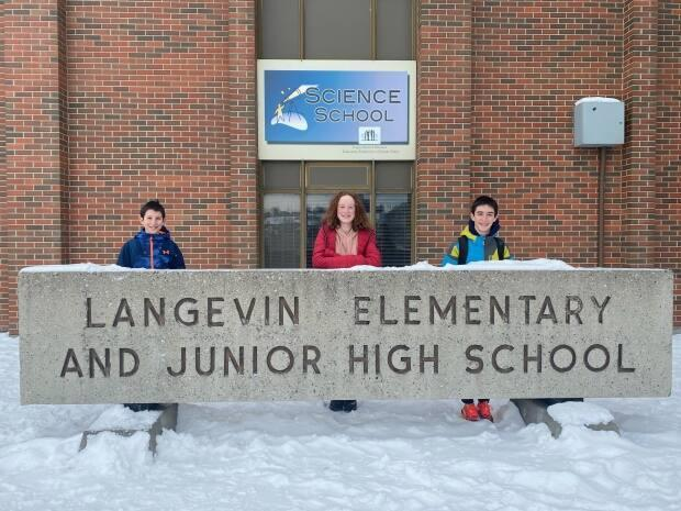Langevin students Seth Helfenbaum (Grade 5), Joy McCullagh (Grade 8), and Zach Helfenbaum (Grade 8) have been advocating to the Calgary Board of Education for years to have the name of their school changed. (Submitted by the Helfenbaum family - image credit)