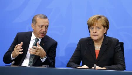 File photo of German Chancellor Merkel and Turkey's Prime Minister Erdogan
