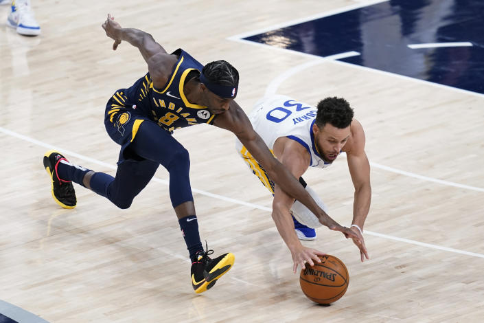 Indiana Pacers' Justin Holiday (8) and Golden State Warriors' Stephen Curry (30) dive for the ball during the second half of an NBA basketball game Wednesday, Feb. 24, 2021, in Indianapolis. (AP Photo/Darron Cummings)
