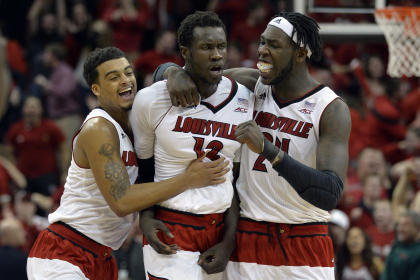 Mangok Mathiang (C) is congratulated by teammates after making the winning shot Saturday. (USAT)