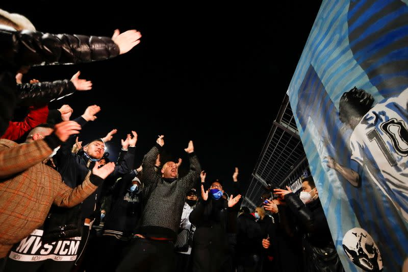 People gather to mourn the death of Argentine soccer legend Diego Maradona, in Naples