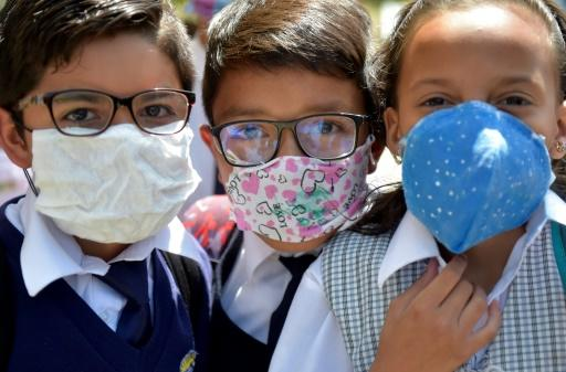 Colombian schoolchildren use masks recyclable and biodegradable materials following a shortage of medical masks as the country fights the spread of the coronavirus