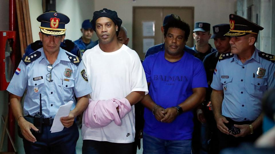 Ronaldinho and his brother Roberto were taken into police custody, shortly after their arrival, when investigators raided their hotel following the discovery that their passports were fake.