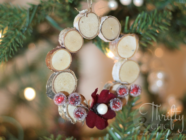 """<p>This adorable woodland wreath requires a few birch discs, a small flower, and some berries. </p><p><strong>Get the tutorial at <a href=""""http://www.thriftyandchic.com/2014/11/mini-woodland-wreath-ornament.html"""" rel=""""nofollow noopener"""" target=""""_blank"""" data-ylk=""""slk:Thrifty and Chic"""" class=""""link rapid-noclick-resp"""">Thrifty and Chic</a>.</strong></p>"""