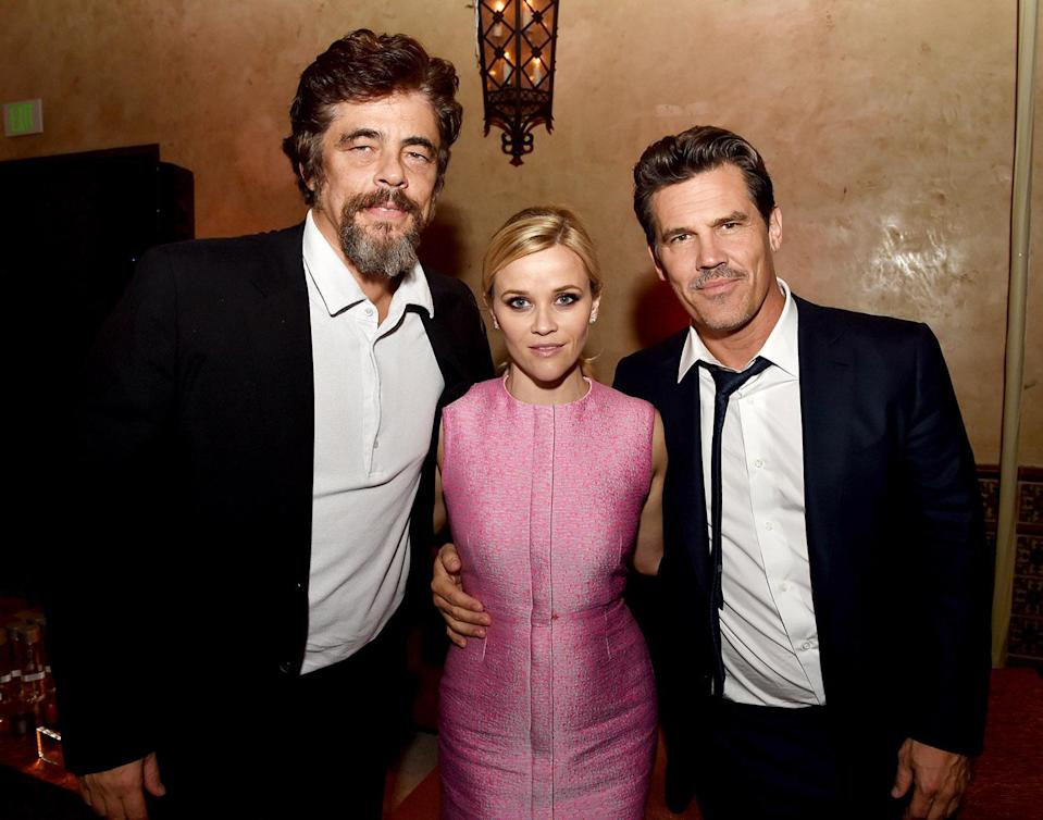 <p>Reese poses with co-stars Benecio Del Toro and Josh Brolin at the Los Angeles premiere of the Paul Thomas Anderson drama.<br> (Photo: Getty Images) </p>