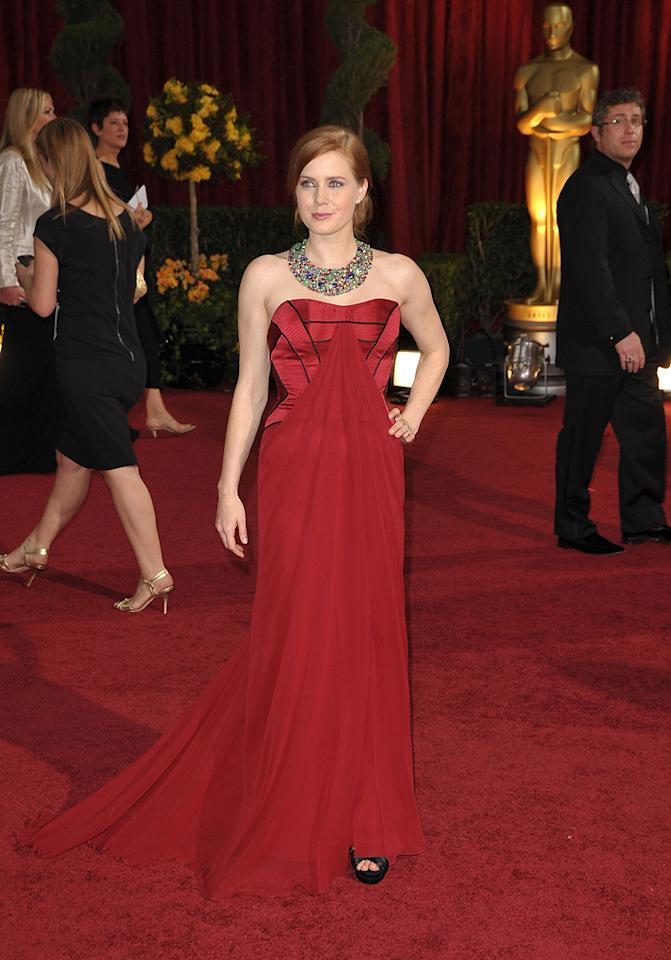 Amy Adams   Grade: B-       The fiery redhead generated mixed reviews in her ruby-red strapless Carolina Herrera creation and massive Fred Leighton necklace.