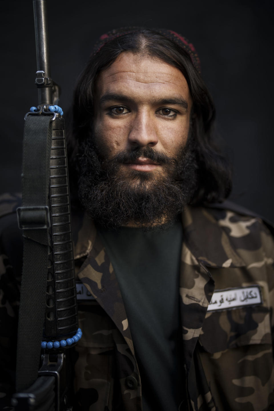 Taliban fighter Hizbullah Fath, 25, poses for a photo at a police station in Kabul, Afghanistan, Saturday, Sept. 18, 2021. Fath spent 3 years in jail and has been with the Taliban for 8 years. (AP Photo/Felipe Dana)