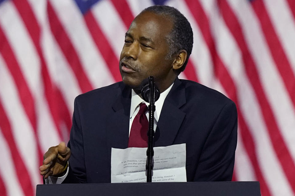 Secretary of Housing and Urban Development Ben Carson holds notes as he speaks during a campaign event before President Donald Trump at the Cobb Galleria Centre, Friday, Sept. 25, 2020, in Atlanta. (AP Photo/John Bazemore)