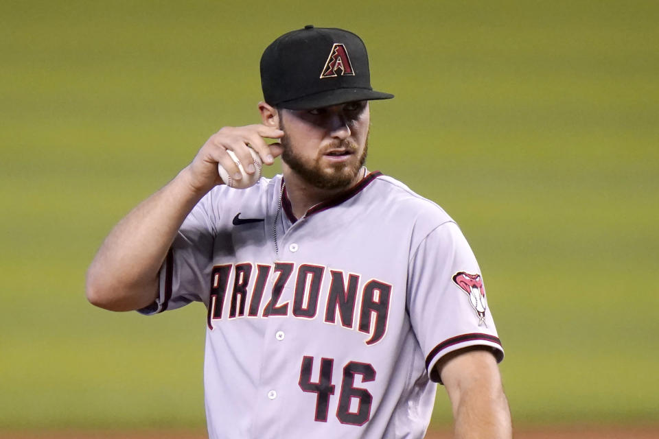Arizona Diamondbacks starting pitcher Riley Smith (46) reacts after giving up a single to Miami Marlins' Adam Duvall during the first inning of a baseball game, Tuesday, May 4, 2021, in Miami. (AP Photo/Lynne Sladky)