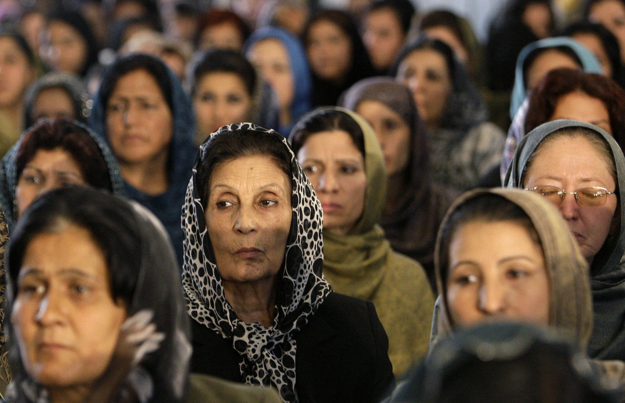 "Afghan women listen to a speech delivered by Afghan President Hamid Karzai during an event marking International Literacy Day in Kabul September 28, 2010. Karzai on Tuesday called on Afghans to ""come to their senses"" and move faster towards peace or risk seeing the next generation flee abroad and lose their Afghan identity. REUTERS/Omar Sobhani (AFGHANISTAN - Tags: POLITICS)"