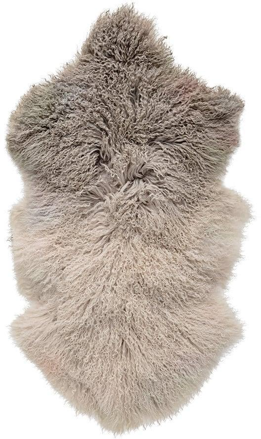 <p>This <span>Tibetan Sheepskin Rug</span> ($161) is crafted from fur which makes it extra soft.</p>
