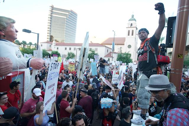 <p>Peace activists rally outside of a Donald Trump campaign rally in Phoenix, Arizona, U.S. August 22, 2017. (Sandy Huffaker/Reuters) </p>