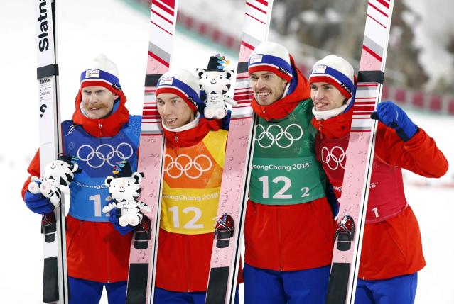 Ski Jumping - Pyeongchang 2018 Winter Olympics - Men's Team Final - Alpensia Ski Jumping Centre - Pyeongchang, South Korea - February 19, 2018 - Gold medalists Robert Johansson, Johann Andre Forfang, Andreas Stjernen and Daniel Andre Tande of Norway celebrate during the victory ceremony. REUTERS/Dominic Ebenbichler