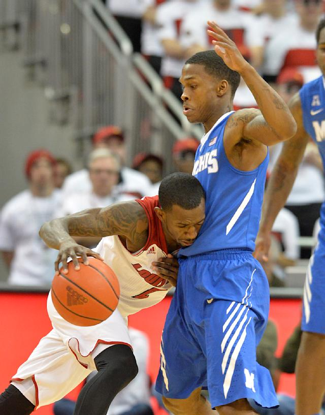 Louisville's Russ Smith, left, runs into the screen of Memphis' Joe Jackson during the first half of an NCAA college basketball game on Thursday Jan. 9, 2014, in Louisville, Ky. (AP Photo/Timothy D. Easley)
