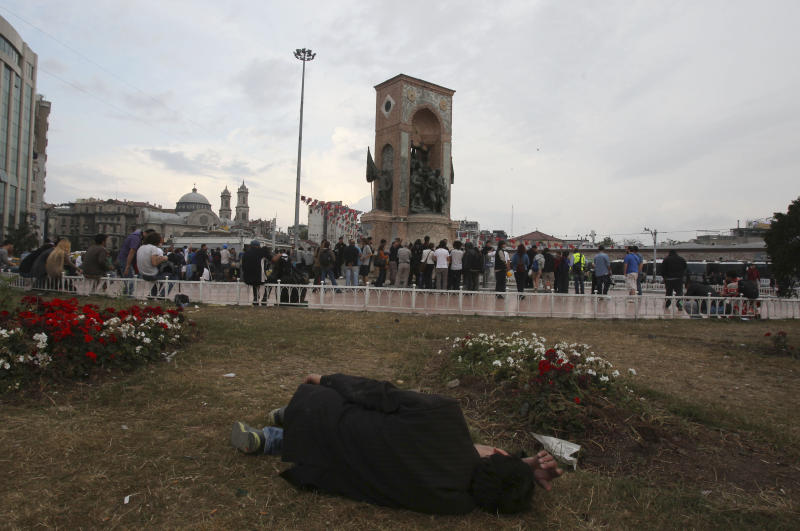 A protester sleeps near the monument of Mustafa Kemal Ataturk, founder of the modern Turkey, at Taksim Square in Istanbul Friday, June 14, 2013. A meeting between Prime Minister Recep Tayyip Erdogan and representatives of anti-government protesters ended early Friday without a clear resolution on how to end the occupation of a central Istanbul park that has become a flashpoint for the largest political crisis of his 10-year rule. (AP Photo/Thanassis Stavrakis)