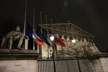 French and European flags fly at half-mast outside the National Assembly in Paris January 7, 2015, following a shooting by gunmen at the offices of weekly satirical magazine Charlie Hebdo. REUTERS/Jacky Naegelen