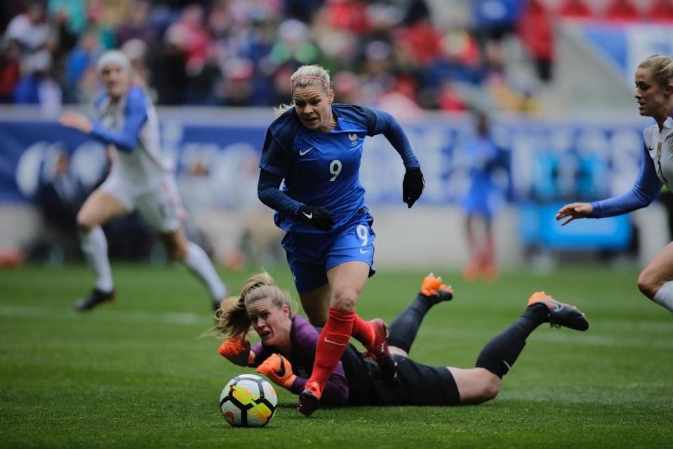 France's Eugenie Le Sommer scores a goal during the first half of a SheBelieves Cup soccer match against US at the Red Bulls Stadium on March 4, 2018 in Harrison, New Jersey (AFP Photo/Kena Betancur)