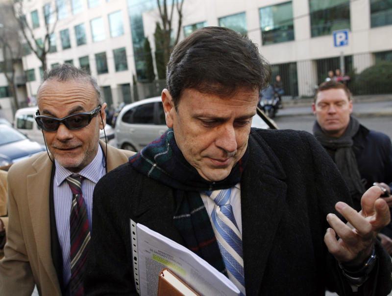 FILE - In this Jan. 28, 2013 file photo, doctor Eufemiano Fuentes arrives at a court house in Madrid, Spain.  Fuentes, the Spanish doctor at the heart of one of cycling's biggest doping scandals was found guilty Tuesday, April 30, 2013 of endangering public health and given a one-year suspended jail sentence in the Operation Puerto case.  (AP Photo/Andres Kudacki, File)