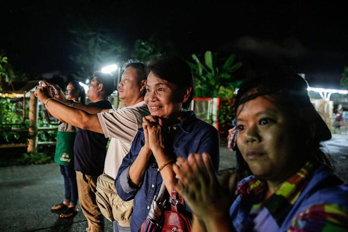 <p>Crowds gather in Chiangrai, Thailand as Thai Navy SEALs rescue the boys soccer team and their coach from a collapsed cave.</p>