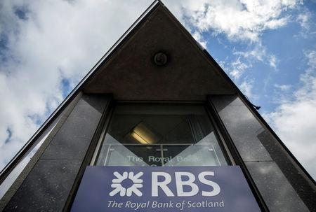FILE PHOTO: A sign is displayed outside of a branch of The Royal Bank of Scotland in central London