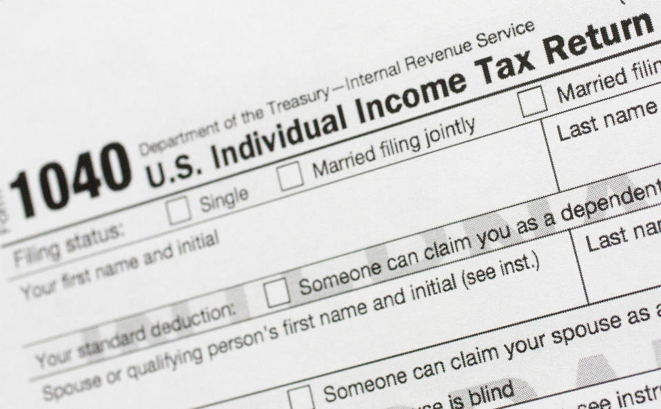 "FILE - This July 24, 2018, file photo shows a portion of the 1040 U.S. Individual Income Tax Return form. The Trump administration is working on plans to delay the April 15 federal tax deadline for most individual taxpayers as well as small businesses. Treasury Secretary Steven Mnuchin told Congress on Wednesday, March 11, 2020, that the administration is ""looking at providing relief to certain taxpayers and small businesses who will be able to get extensions on their taxes."" (AP Photo/Mark Lennihan, File)"