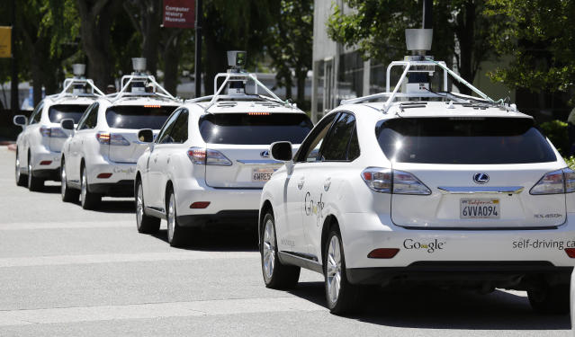 A row of Google self-driving cars are shown outside the Computer History Museum in Mountain View, Calif. (AP Photo/Eric Risberg)