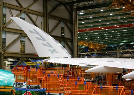 The signature folding wingtip of a 777X aircraft is seen during a media tour of the Boeing 777X at the Boeing production facility in Everett