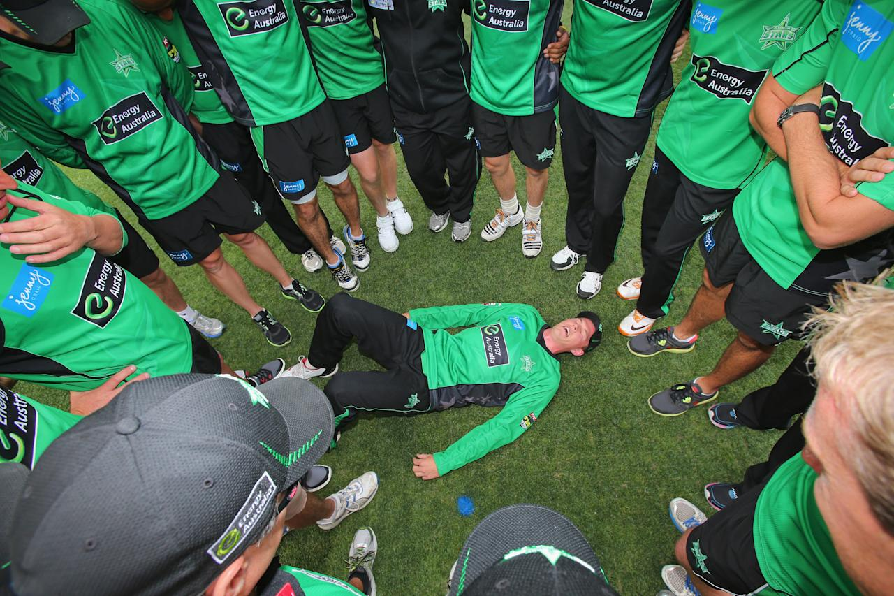 MELBOURNE, AUSTRALIA - DECEMBER 21:  The Stars surround Scott Henry as he lies on the ground before he makes his debut during the Big Bash League match between the Melbourne Stars and the Sydney Sixers at Melbourne Cricket Ground on December 21, 2012 in Melbourne, Australia.  (Photo by Scott Barbour/Getty Images)