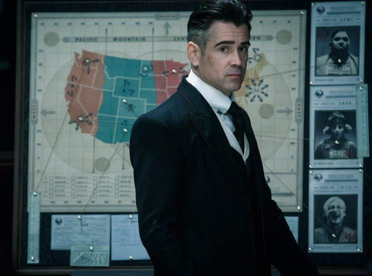 MACUSA director Percival Graves stands before a map of the most wanted wizards (Photo: Warner Bros.)