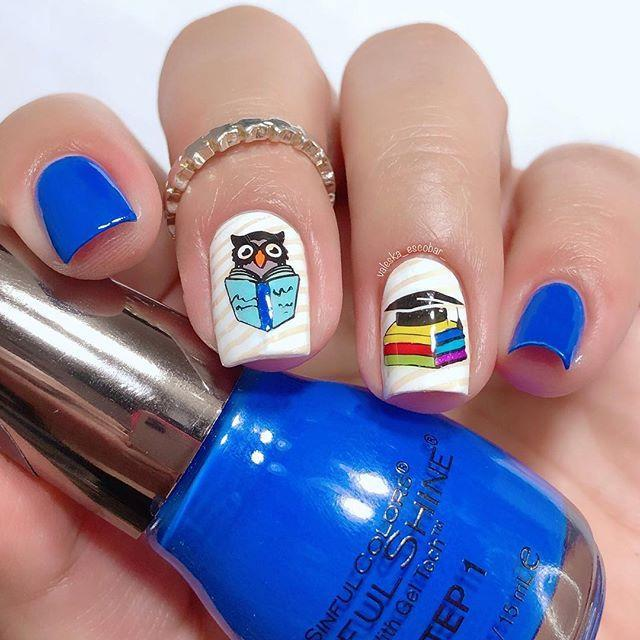 """<p>Your avid reader might want her nails to match her passion. You can find decals or use a steady hand to draw a reading owl and stack of books.</p><p><a class=""""link rapid-noclick-resp"""" href=""""https://www.amazon.com/Graduation-Owls-Nail-Art-Decals/dp/B01BQZ3JV4/ref=sr_1_6?tag=syn-yahoo-20&ascsubtag=%5Bartid%7C10055.g.22590646%5Bsrc%7Cyahoo-us"""" rel=""""nofollow noopener"""" target=""""_blank"""" data-ylk=""""slk:SHOP OWL DECALS"""">SHOP OWL DECALS</a></p><p><a href=""""https://www.instagram.com/p/Bnew31NA-69/&hidecaption=true"""" rel=""""nofollow noopener"""" target=""""_blank"""" data-ylk=""""slk:See the original post on Instagram"""" class=""""link rapid-noclick-resp"""">See the original post on Instagram</a></p>"""