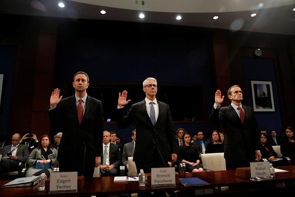 Twitter Acting General Counsel Sean Edgett, Facebook General Counsel Colin Stretch and Google Senior Vice President and General Counsel Kent Walker are sworn in before the House Intelligence Committee to answer questions related to Russian use of social media to influence U.S. elections, on Capitol Hill in Washington, U.S., November 1, 2017. REUTERS/Aaron P. Bernstein