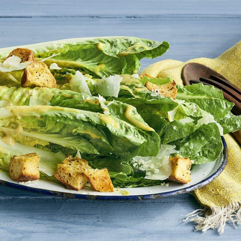 """<p>Instead of chopping the lettuce, Ree's version of this classic salad uses spears of Romaine lettuce hearts. It's a fun and fancy presentation that's perfect for the holidays.</p><p><a href=""""https://www.thepioneerwoman.com/food-cooking/recipes/a35823712/caesar-salad-spears-recipe/"""" rel=""""nofollow noopener"""" target=""""_blank"""" data-ylk=""""slk:Get Ree's recipe."""" class=""""link rapid-noclick-resp""""><strong>Get Ree's recipe.</strong></a></p>"""