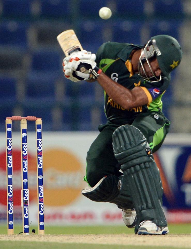 Pakistani cricketer Wahab Riaz avoids a ball during the third day-night international in Sheikh Zayed Cricket Stadium in Abu Dhabi on Novemver 6, 2013. South Africa produced a clincal performance to beat Pakistan by 68 runs in the third day-night international and take a 2-1 lead in the five-match series. AFP PHOTO/ Asif HASSAN        (Photo credit should read ASIF HASSAN/AFP/Getty Images)