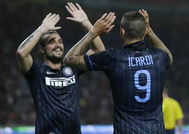 Inter Milan forward Mauro Icardi, of Argentina, back to camera, celebrates with his teammate forward Pablo Daniel Osvaldo after scoring during an Europa League play-off match between Inter Milan and Stjarnan at the San Siro stadium in Milan, Italy, Thursday, Aug. 28, 2014. (AP Photo/Luca Bruno)