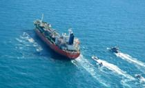 Iran's Revolutionary Guards navy on Monday seized the South Korean-flagged tanker with 20 crew and escorted it to an Iranian port