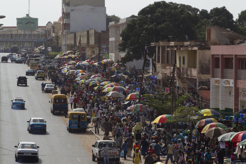 FILE - In this May 27, 2012 file photo, shoppers and vendors crowd the street at the city's main Bandim Market, in Bissau, Guinea-Bissau. A senior United Nations official said Wednesday, July 10, 2013 that planned November elections in the tiny West African nation of Guinea-Bissau can't be seen as free and fair unless progress is made on investigations of recent high-profile political killings. (AP Photo/Rebecca Blackwell, File)