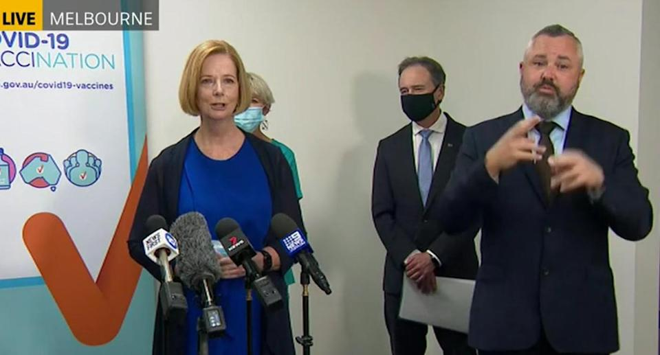 Former Australian Prime Minister Julia Gillard and Health Minister Greg Hunt call for people to get vaccinated.