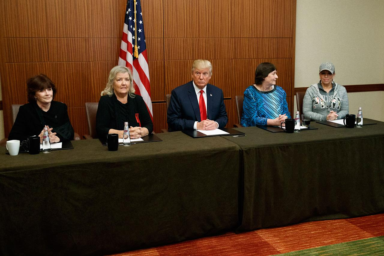 <p>Republican presidential candidate Donald Trump, center, sits with, from right, Paula Jones, Kathy Shelton, Juanita Broaddrick, and Kathleen Willey, before the second presidential debate with Democratic presidential candidate Hillary Clinton at Washington University, Sunday, Oct. 9, 2016, in St. Louis, Mo. (Photo: Evan Vucci/AP) </p>