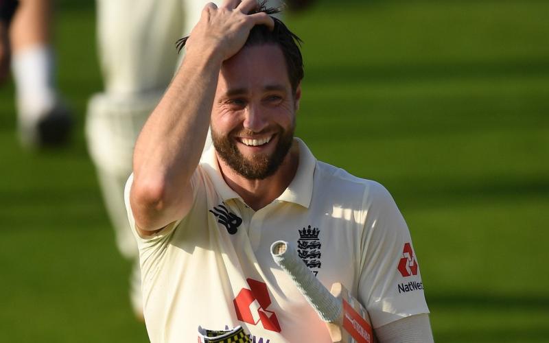 A smiling Chris Woakes walks off the pitch after winning the first Test for England - GETTY IMAGES