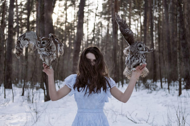 <p>In true storybook style, the images were taken deep in a snow-covered forest. (Photo: Olga Barantseva/Caters News) </p>